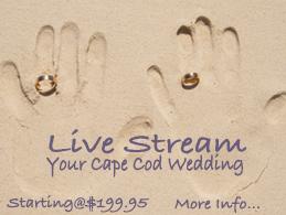 Hand print on sand beach with wedding rings.